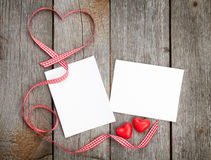 Two photo frames over wooden background Royalty Free Stock Photography