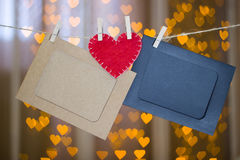 Two photo frames and red heart made of felt. Royalty Free Stock Photography
