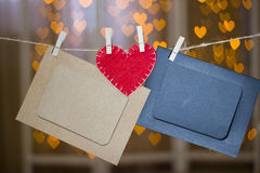 Two photo frames and red heart made of felt. Royalty Free Stock Photos