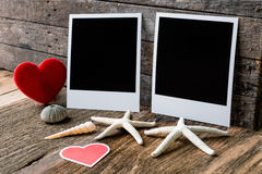 Two photo frames and valentines day  heart over wooden backgroun Royalty Free Stock Photography