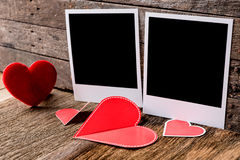Two photo frames and valentines day  heart over wooden backgroun Royalty Free Stock Images