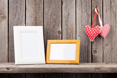 Two photo frames and Valentines day hearts Royalty Free Stock Images