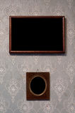 Two photo-frames on wall Royalty Free Stock Image