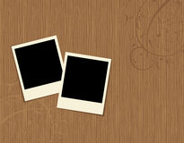 Two photo frames on wooden background Stock Images