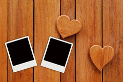 Two photo on hearts wooden background. Frame stock illustration