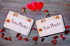 Two photo paper attach to rope with clothes pins on wooden background Royalty Free Stock Photography