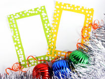 Two photoframes with decorative balls and tinsel Royalty Free Stock Image