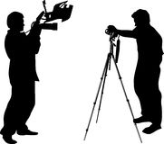 Two photographer silhouettes Stock Photos
