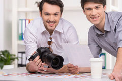 Two photographers selecting photos. Royalty Free Stock Images