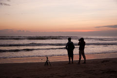 Two photographers taking a picture of the ocean Royalty Free Stock Photo