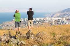 Two photographers taking picture of Tiberias sea. Stock Images