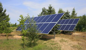 Two photovoltaic panels set in backyard Royalty Free Stock Photos