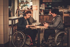 Two physically challenged women in a cafe.  Stock Images