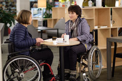 Two physically challenged women in a cafe.  Stock Photography
