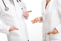 Two physicians during council. Two physicians gesticulating during a medical council royalty free stock photo