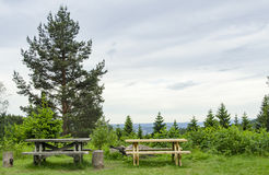 Two picnic tables in nature stock photo