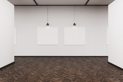 Two pictures in a dark wood floor art gallery. Two pictures are hanging on a white wall in an art gallery with dark wood floor. Concept of advertising. 3d Stock Photo
