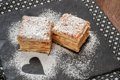 Two piece of Mille-Feuille puff pastry or Napoleon Royalty Free Stock Photo
