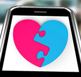 Two-Pieced Heart On Smartphone Showing Complement Royalty Free Stock Photography