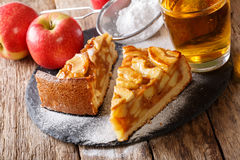 Two pieces of apple pie close-up and apple juice. horizontal Stock Photo