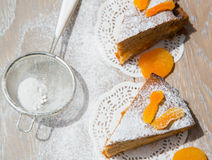Two pieces of apricot pie on the wooden surface Royalty Free Stock Image