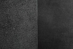 Two pieces of black leather. Nubuck and smooth  leather surface Royalty Free Stock Photo