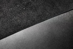 Two pieces of black leather. Nubuck and smooth  leather surface Royalty Free Stock Image