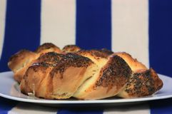 Two pieces of bread front of blue white cloth stock image