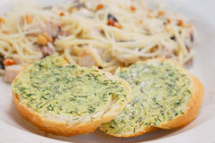 Two pieces of bread with green butter Royalty Free Stock Images