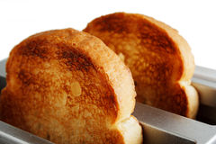 Two pieces of bread in the toaster Royalty Free Stock Images