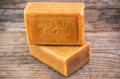 Two pieces of brown soap Royalty Free Stock Photos