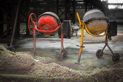 Two pieces of cement mixer in an old factory. Cement mixer in an old factory Royalty Free Stock Photo