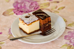 Two pieces of cheesecake Stock Photography
