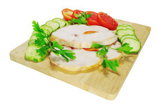 Two pieces of chicken ham with vegetables Royalty Free Stock Images