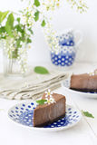 Two pieces of chocolate cheesecake Stock Photos
