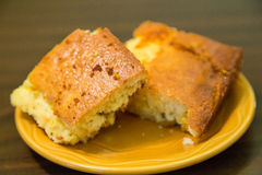 Two Pieces of Cornbread on Plate Royalty Free Stock Photography