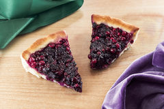 Two pieces of cow berry pie. Stock Photos