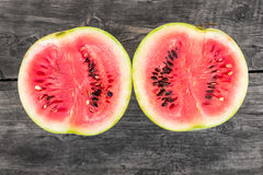 Two pieces of cut in half ripe fresh watermelon Stock Images
