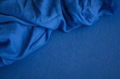 Two pieces of different deep blue fabrics royalty free stock photos