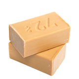 Two pieces of economic simple natural soap. Stock Photo