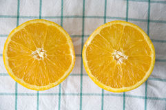 Two pieces of fresh orange. Cut on top Stock Images