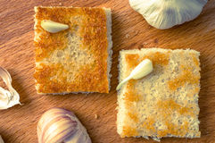 Two pieces of fried bread with garlic Royalty Free Stock Images