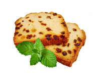 Two pieces of fruitcake and green mint Stock Image