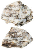Two pieces of Gneiss mineral stone isolated. Macro shooting of specimen natural rock - two pieces of Gneiss mineral stone isolated on white background Stock Photo