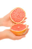 Two pieces of grapefruit stock photo