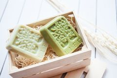 Beautiful, fragrant handmade soap in wooden box standing on a wooden background royalty free stock photography