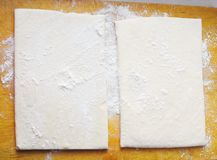 Two pieces of homemade dough Stock Photos