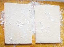 Two pieces of homemade dough Stock Photos