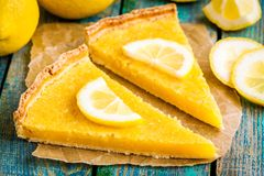 Two pieces of lemon tart with slice of lemons closeup Royalty Free Stock Photos