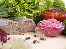 Two pieces of liver sausage Royalty Free Stock Images